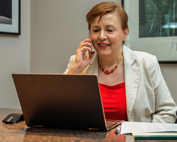 Cindy talking to a client on the phone